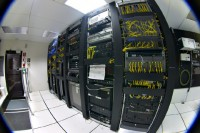 Telecommunications equipment in one corner of a small data center. Contributed and licensed under the GFDL by the photographer, Gregory Maxwell.